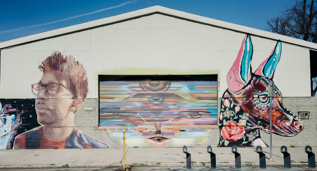 Senkoe Mural in Sacramento of man and dog